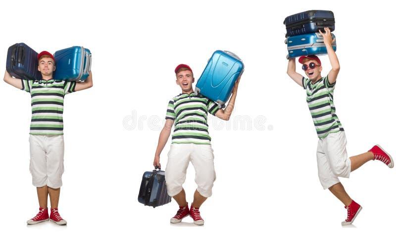 Den unga mannen med tunga resväskor som isoleras på vit arkivfoto