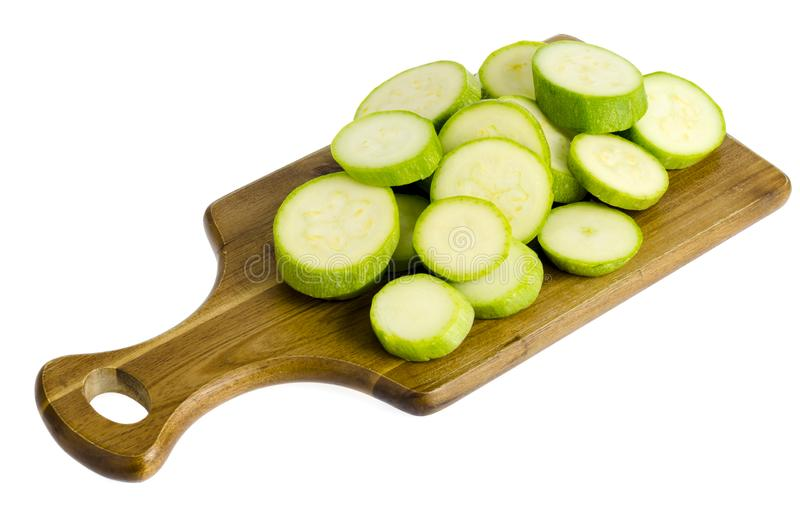 Den unga nya gröna zucchinin skivade arkivfoto