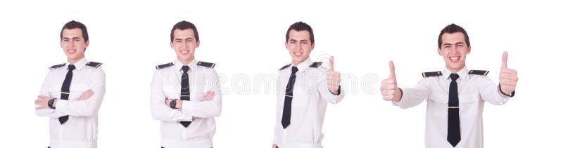 Den unga piloten som isoleras p? viten royaltyfri foto