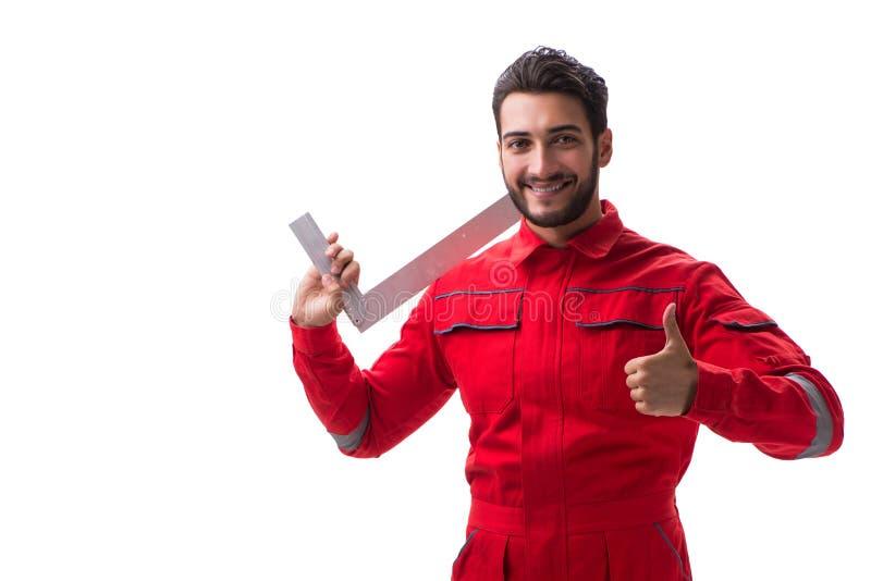 Den unga repairmanen med en fyrkantig linjal som isoleras på vit bakgrund arkivfoton