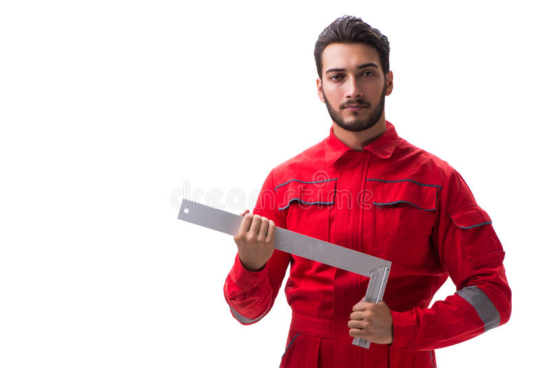 Den unga repairmanen med en fyrkantig linjal som isoleras på vit bakgrund royaltyfri fotografi