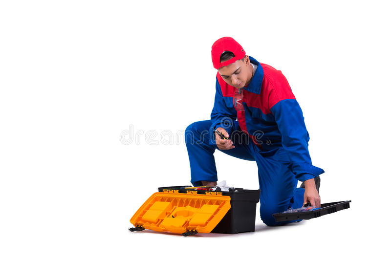 Den unga repairmanen med skiftnyckelskruvnyckeln som isoleras på vit fotografering för bildbyråer