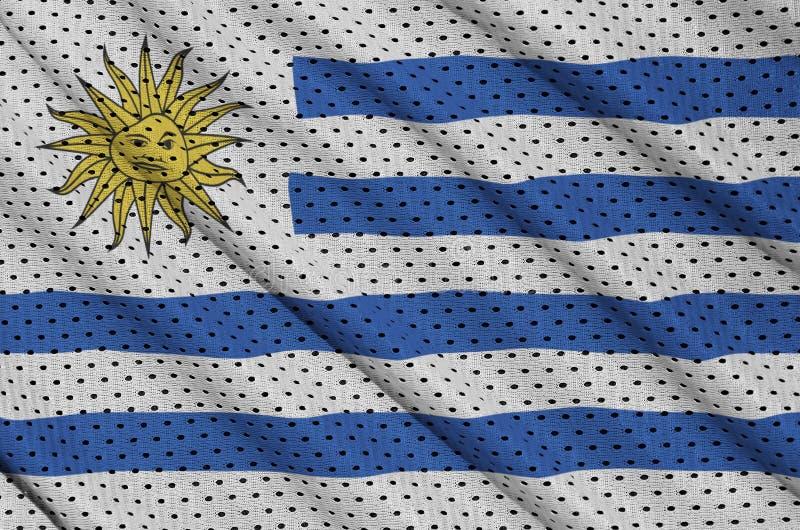 Den Uruguay flaggan skrivev ut på ett tyg för ingrepp för polyesternylonsportswear royaltyfri foto