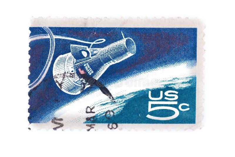Den utskrivavna USA A stämpeln visar kapseln och jordklotet för kamratskap som 7 är pro- royaltyfri foto