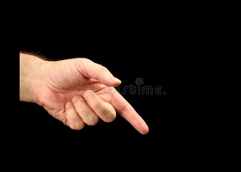Den vänstra manliga handen med pekfingret visar riktning arkivbilder