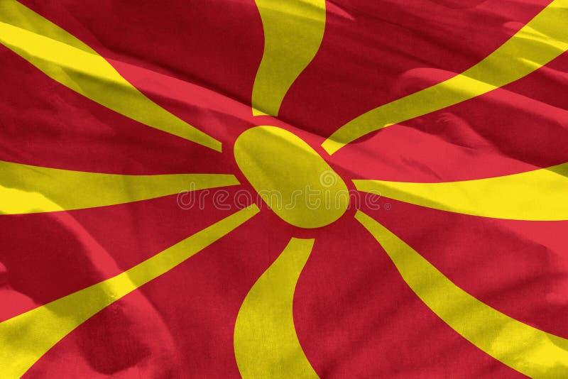 Den vinkande Makedonien flaggan för att använda som textur eller bakgrund, flaggan fladdrar på vinden arkivfoto