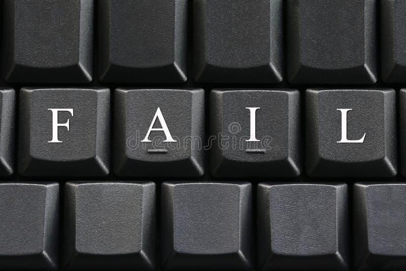 Den vita bokstaven av kuggningen på bakgrund för datortangentbord royaltyfri foto