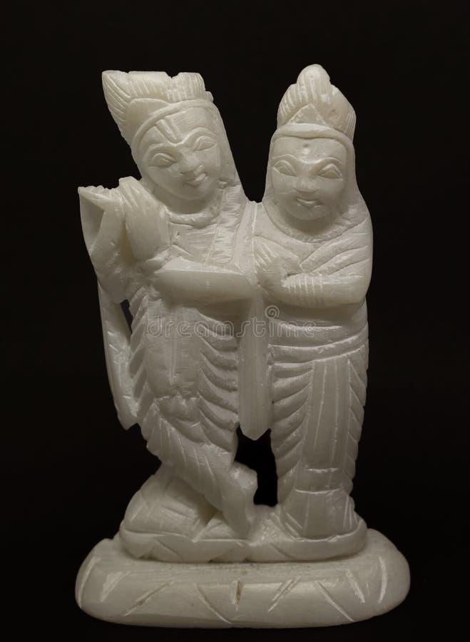 Den vita stenRadha Krishna förebilden, är den hinduiska gudinnan av föreställer evigt förälskade unga gudomliga enheter med de arkivfoton