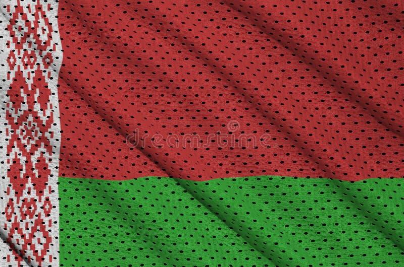 Den Vitryssland flaggan skrivev ut på ett tyg för ingrepp för polyesternylonsportswear royaltyfri foto