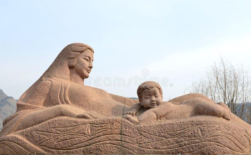 Den Yellow River moderskulpturen arkivfoton