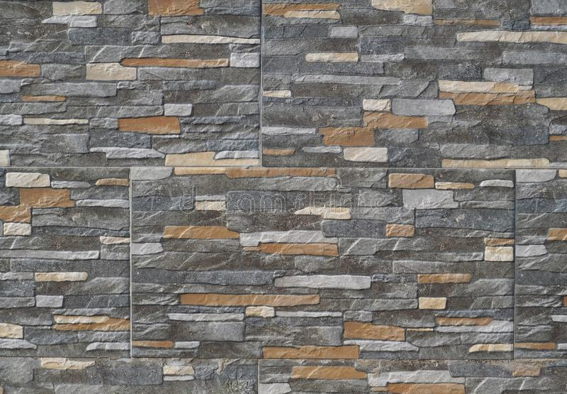 Den yttre claddingväggen som göras av stengodset med, vaggar effekt Bakgrund och texturerar arkivbild