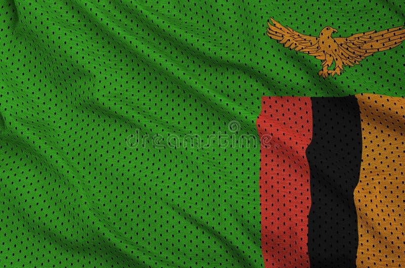 Den Zambia flaggan skrivev ut på ett tyg för ingrepp för polyesternylonsportswear royaltyfri bild