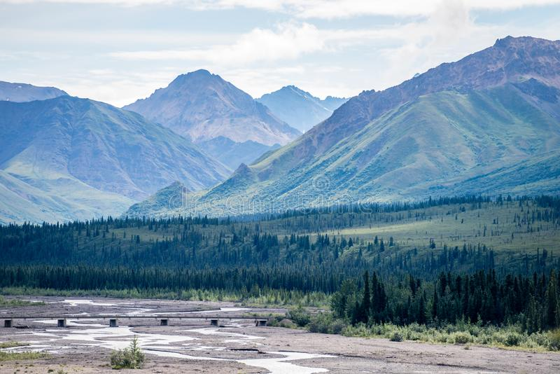 Gravel Flats and Massive Mountains in Alaska`s Denali National Park royalty free stock image