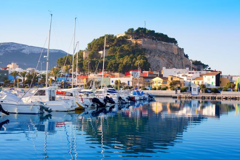 Denia mediterranean port village with castle. Mountain and blue sea water stock photos