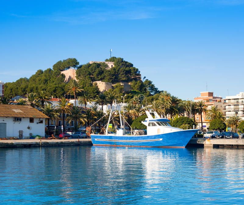 Denia mediterranean port village with castle. Mountain and blue sea water stock images