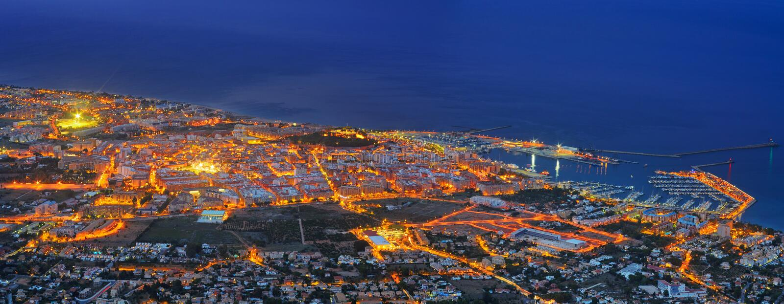 Denia port in night. View of seaside part of Denia and sea port in night. Spain royalty free stock photo