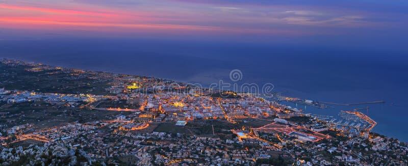 Denia port in twilight. View of seaside part of Denia and sea port in twilight. Spain stock photo