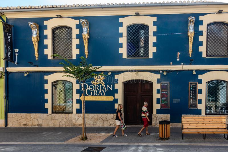 Dorian Gray Restaurant. Denia, Valenciana, Spain - Sept 23 2019 : Dorian Gray Restaurant in streets of Denia with tourists wandering around royalty free stock image