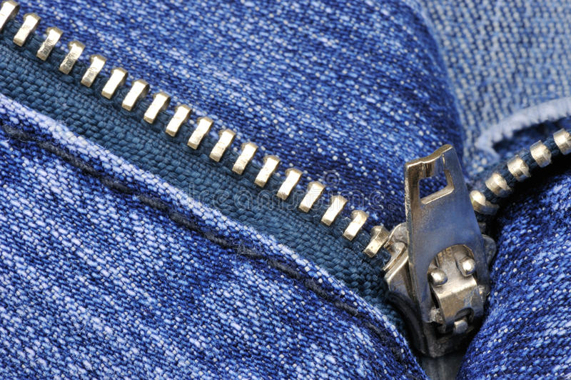 Denim. Close-up picture of denim trousers with an open zipper stock photography