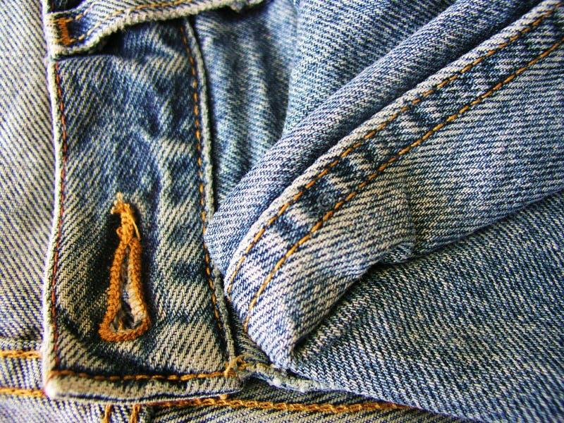 Denim. Old denim jeans lying on the shelf royalty free stock photography