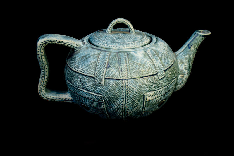 Denim blue jean China Kettle Teapot isolated. Background stock photography