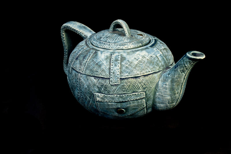 Denim blue jean China Kettle Teapot isolated. Background stock images