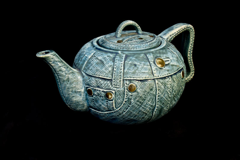 Denim blue jean China Kettle Teapot isolated. Background royalty free stock photography