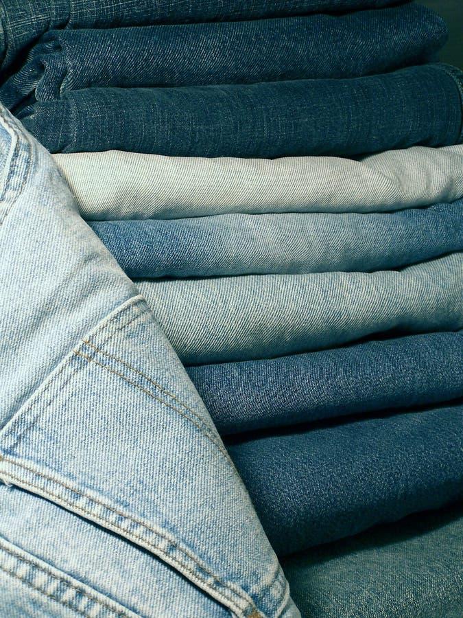 Denim blue jeans. A stack of denim Blue jeans stock photos
