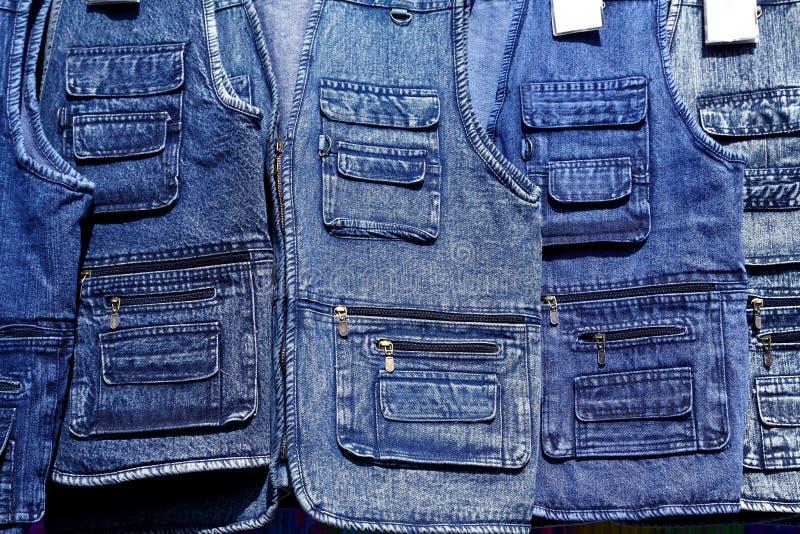 Denim blue jeans vest rows in a retail shop
