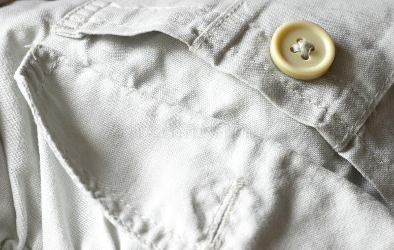 Denim cloth. Trouser button on denim cloth royalty free stock image