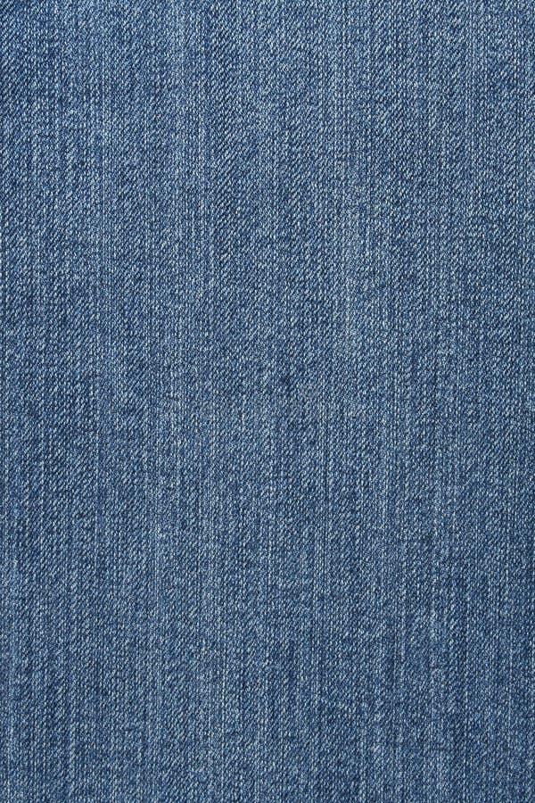 Denim cloth. Close-up of denim cloth royalty free stock photo