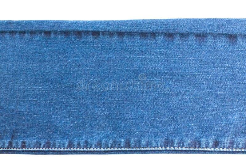 Denim e jeans fondo, parte dei jeans con le cuciture, lungo, isolate fotografia stock