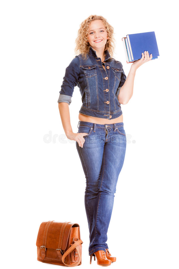 Denim fashion. Full length student girl in blue jeans bag books. Denim fashion and education. Full length college university student girl with bag books, casual stock photo