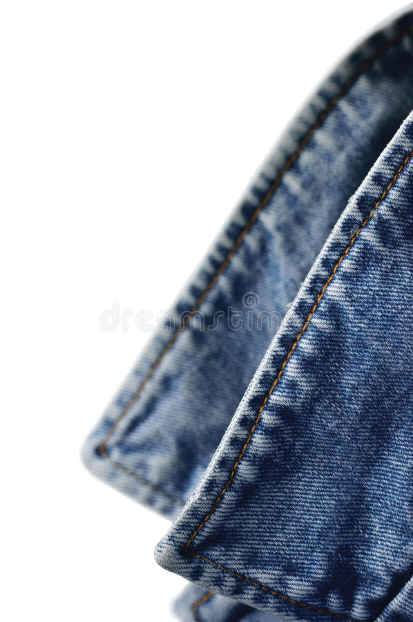 Denim indigo blue jeans jacket collar, isolated macro closeup, large detailed vertical classic bluejeans studio shot. Denim indigo blue jeans jacket collar royalty free stock photography