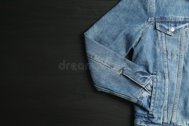 Denim jacket on black background stock images