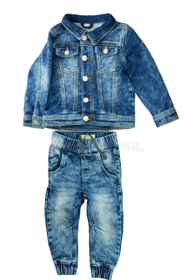 Denim jacket and jeans pants fit together. Fashionable jeans jacket and trouser for child boy. Top view front. stock image
