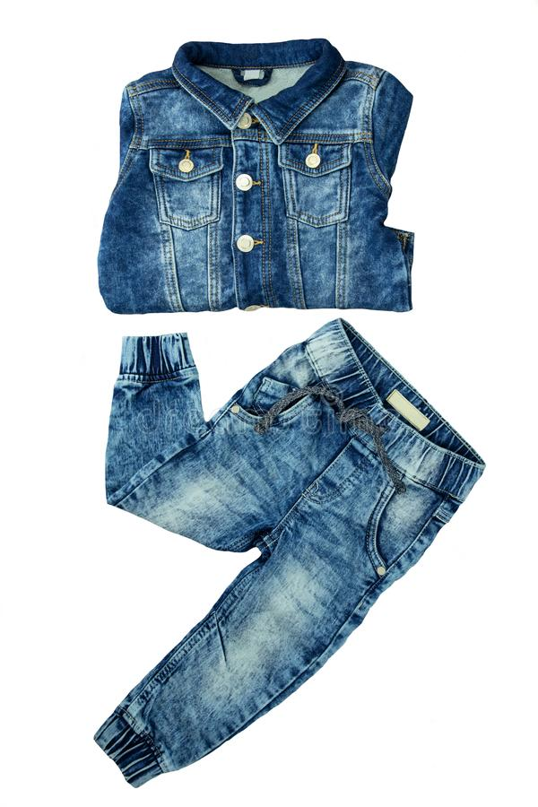 Denim jacket and jeans pants presented together. Jacket and trouser are folded. Fashionable jeans jacket and trouser for child bo. Y. Top view front stock images