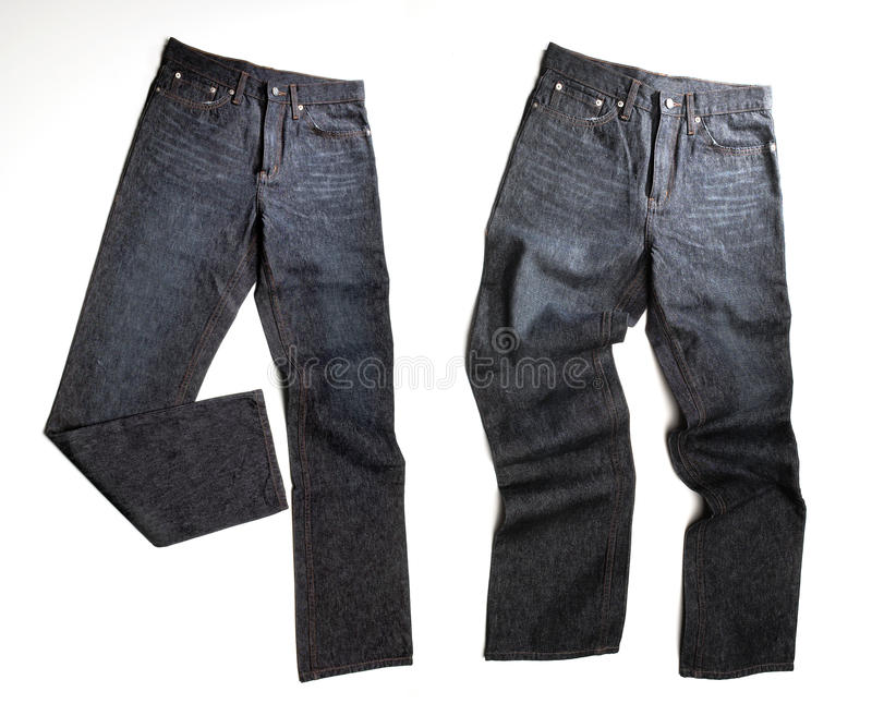 Denim jeans. A pair of denim jeans isolated on white royalty free stock photos