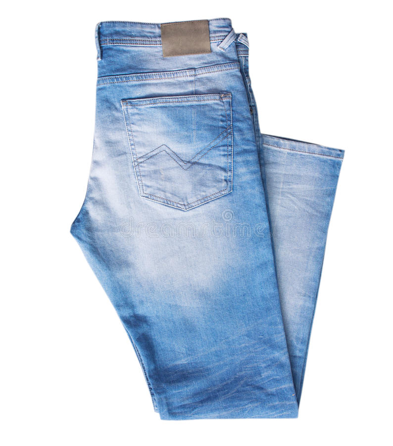 Denim jeans isolated on white nobody. Denim jeans trousers blue color folded isolated on white stock photo