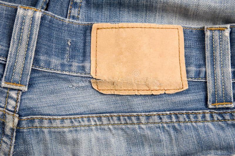 Denim label. Front view of denim label, blue jeans and leather label stock image