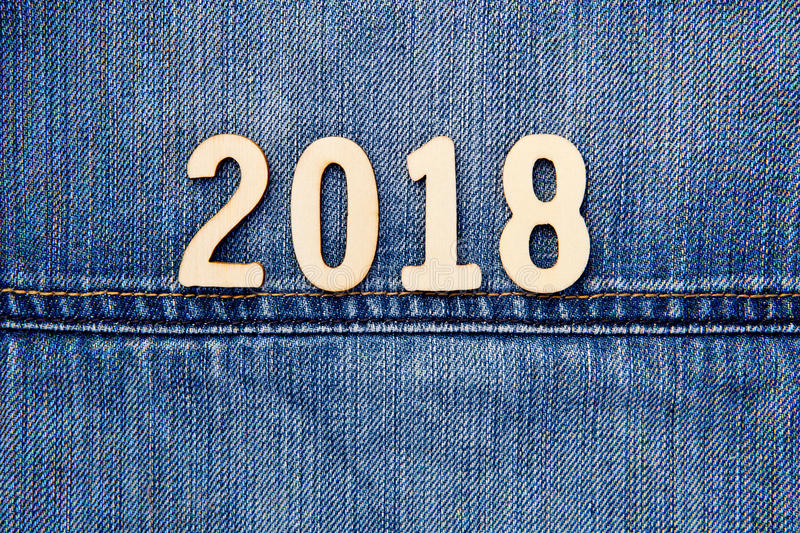 Denim 2018. Numbers on blue denim background royalty free stock photography