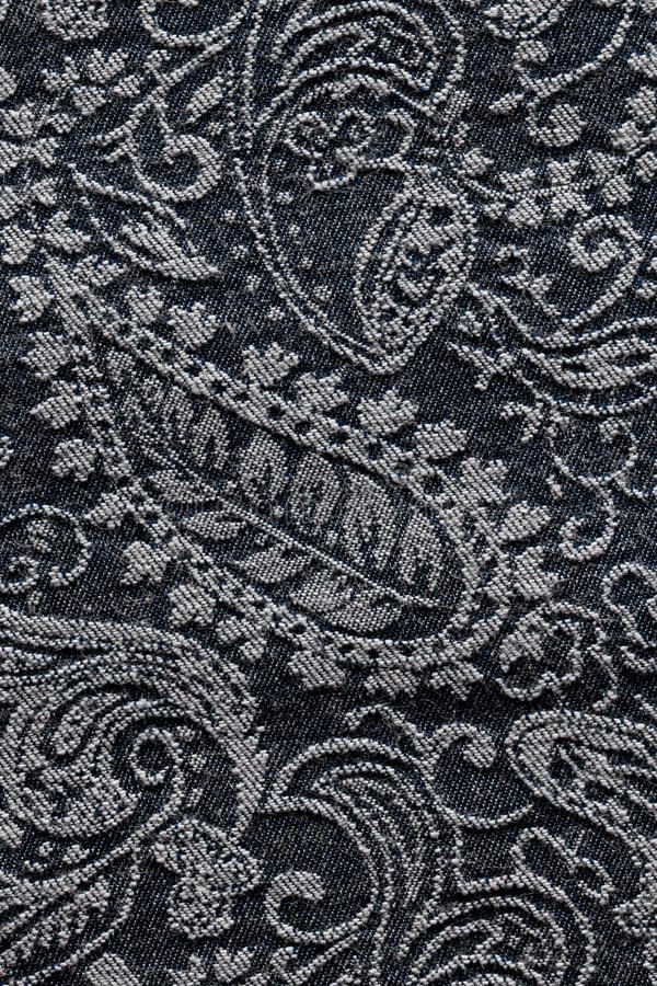 Denim paisley fabric texture background. Detail of denim paisley fabric texture background royalty free stock images