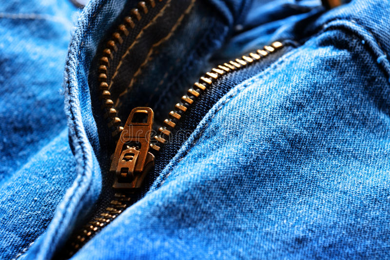 Denim Pants Button. Denim pants with detail of brass button and seams stock photography