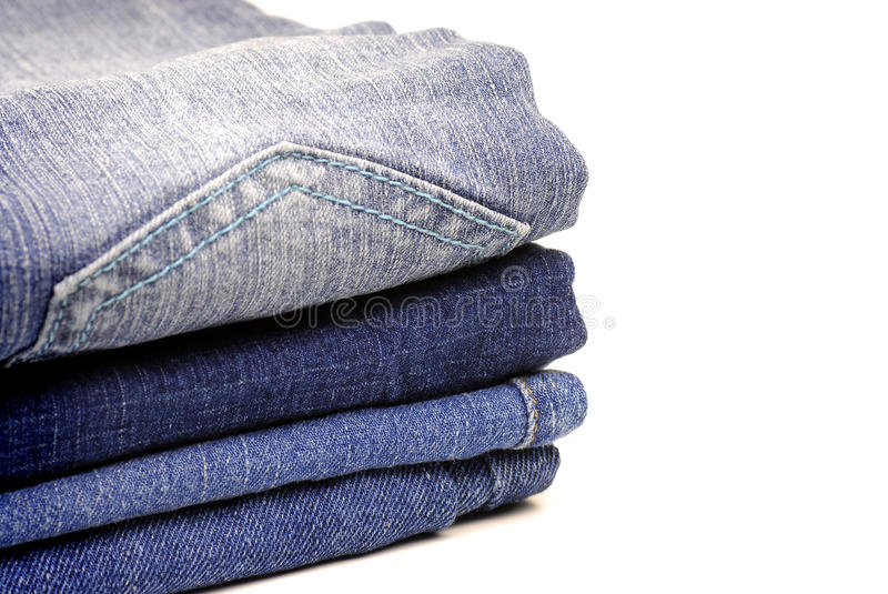 Denim Pants Stacked. Stack of denim pants isolated on white background stock photos