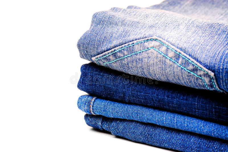 Denim Pants Stacked. Stack of denim pants isolated on white background stock photography