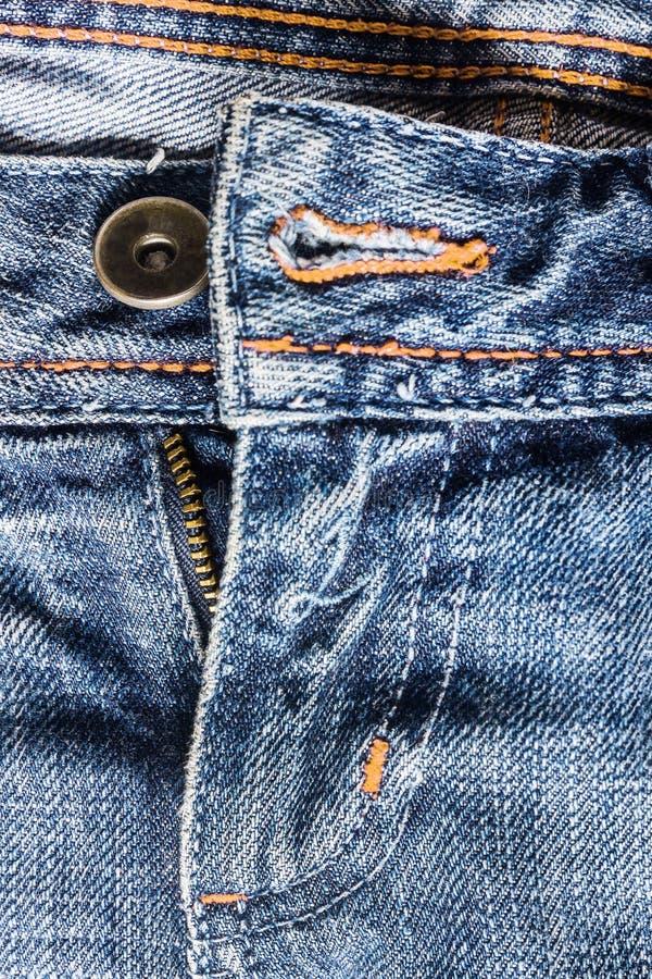 Denim pants to unfasten the zipper close-up.  stock images