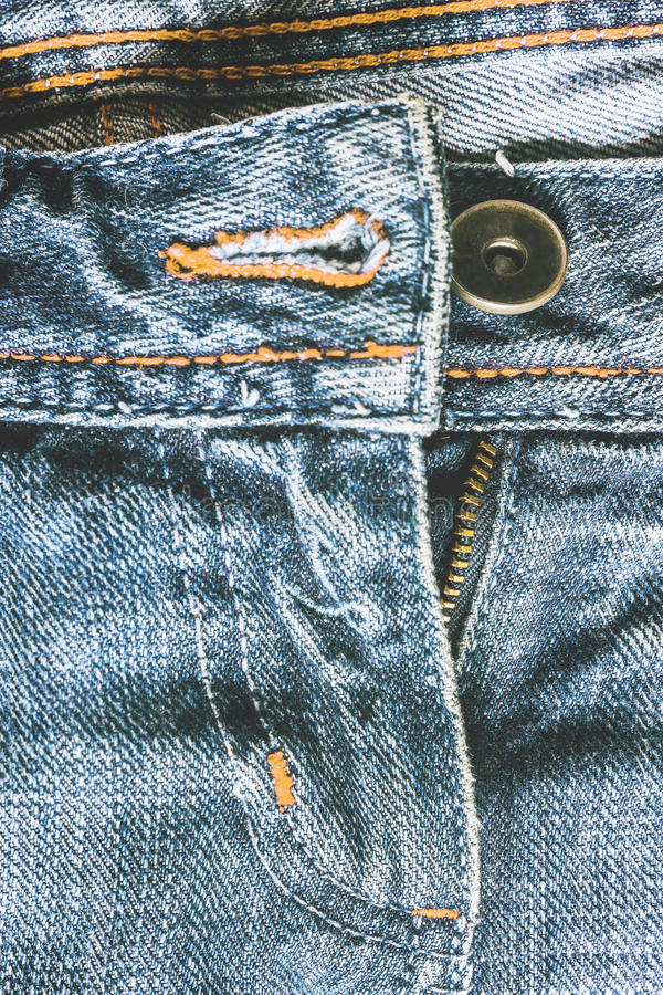 Denim pants to unfasten the zipper close-up.  royalty free stock image