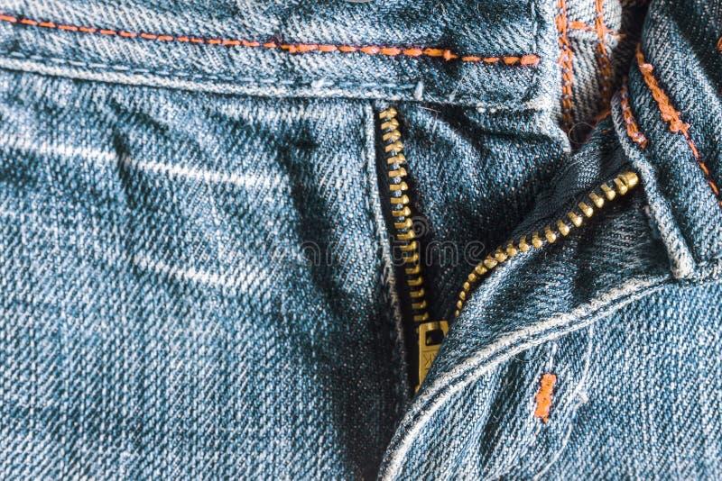 Denim pants to unfasten the zipper close-up.  royalty free stock photos