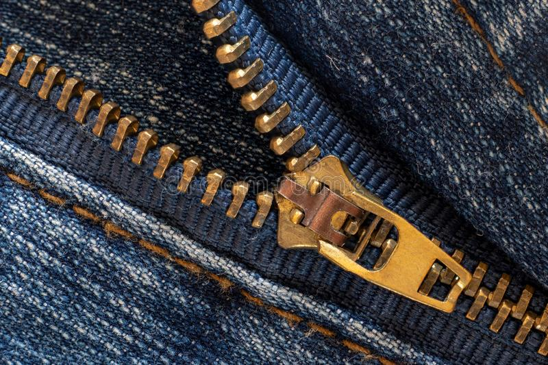 Denim or rough cotton fabric or jeans material with the zipper royalty free stock photo