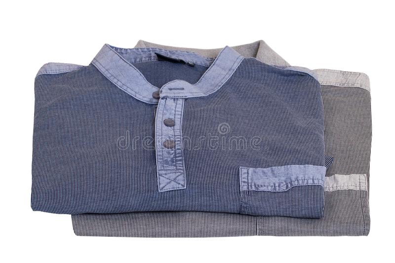 Denim shirts . Close-up of a stylish striped blue jeans shirt and a gray polo shirt for mens isolated on a white. Background. Macro of mens shirt summer fashion royalty free stock photography